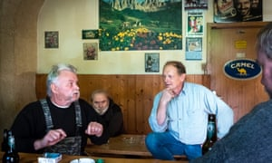 Peter Hampel, right,  with other AFD supporters in the back room of a former petrol station