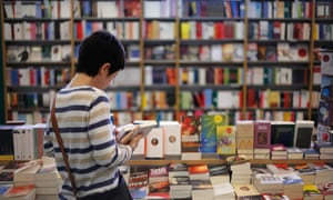 Woman reading in books in a bookshop