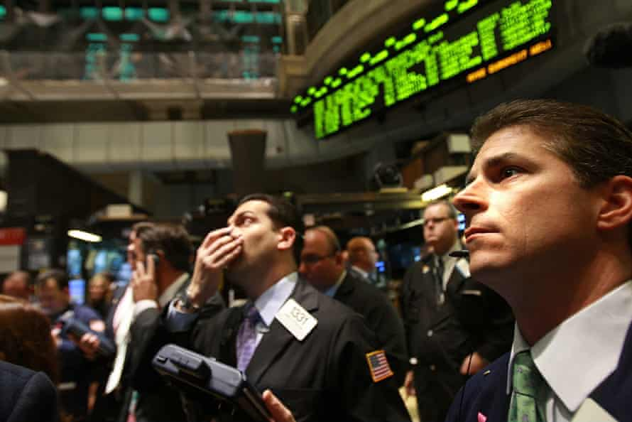 Traders on the floor of the New York stock exchange moments in 2008.