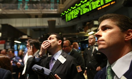Traders work on the floor of the New York Stock Exchange in 2008