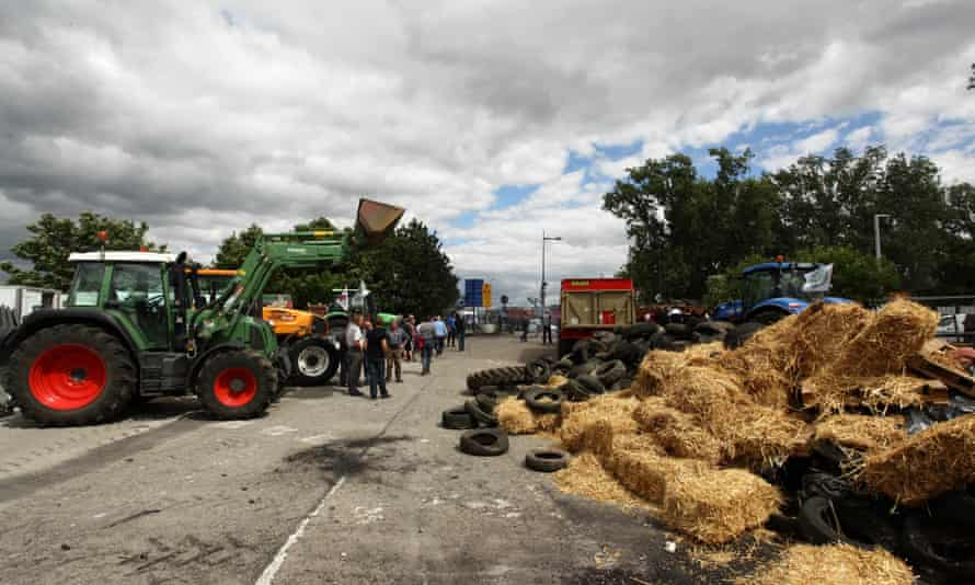 Farmers use tyres and hay bales to form a blockade