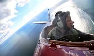 Pilot Pedro Langdon in his Travel Air 4000 biplane