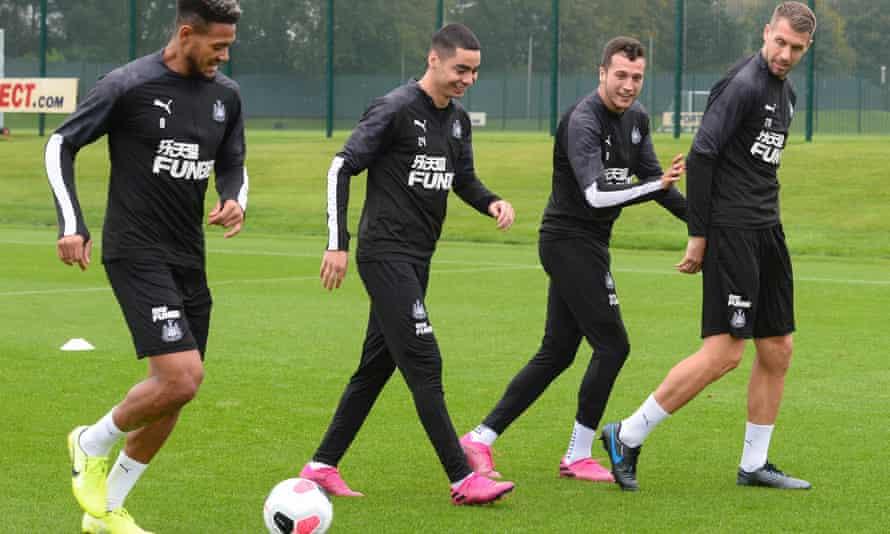 Joelinton, Miguel Almirón, Javier Manquillo and Florian Lejeune warm up before training.