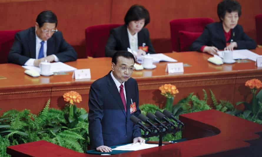 Li Keqiang delivers his report during the opening session of the national people's congress.