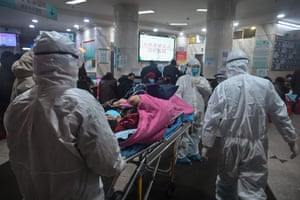 Medical staff wearing protective clothing to protect against a previously unknown coronavirus arrive with a patient at the Wuhan Red Cross Hospital in Wuhan. - The number of confirmed deaths from a viral outbreak in China has risen to 54, with authorities in hard-hit Hubei province on January 26 reporting 13 more fatalities and 323 new cases