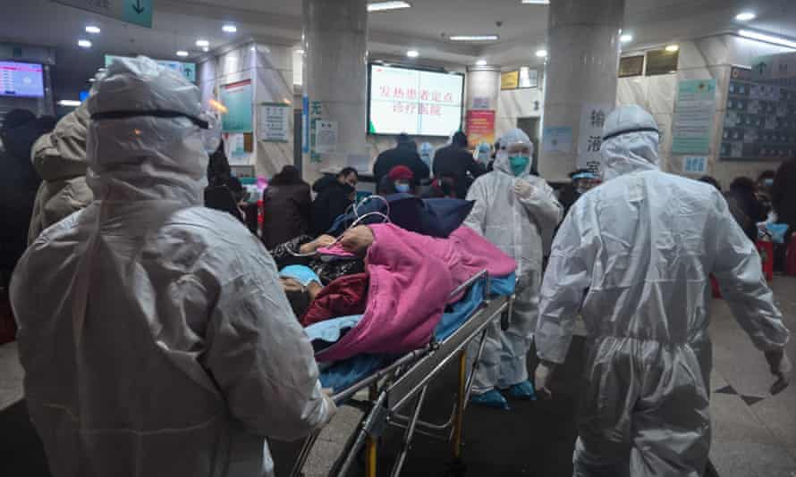 Medical staff with a patient at the Wuhan Red Cross Hospital.