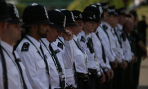 Police officers line up to observe a minute's silence at the Wimbledon tennis championships.