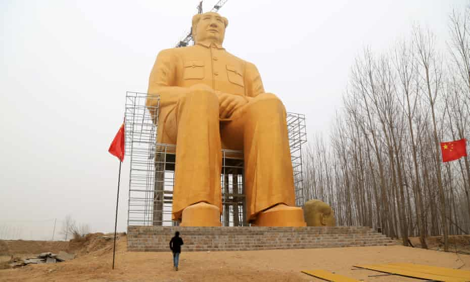 A visitor shows the scale of the huge statue.
