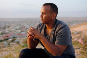 Mohamed, 28, watches the sunset on a hill overlooking Hargeisa.
