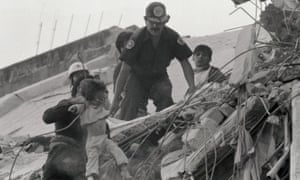 A child is pulled from earthquake wreckage
