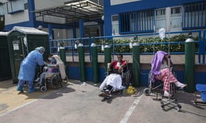 People infected with Covid-19 wait for an available bed outside a public hospital in Lima, Peru, Thursday, 30 April 2020.