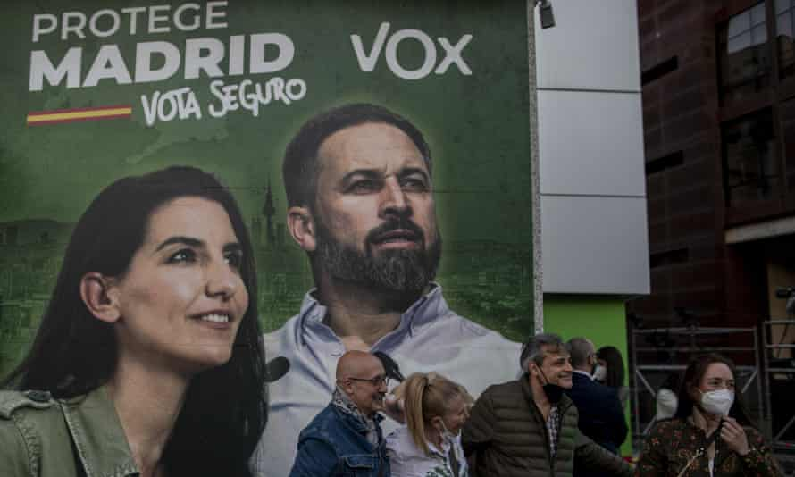 Outside the Vox party headquarters in Madrid on Tuesday, 4 May. The poster depicts party leaders Rocio Monasterio (l) and Santiago Abascal.