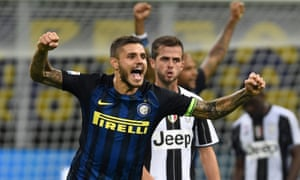Mauro Icardi celebrates Inter's victory at the end of their match with Juventus.