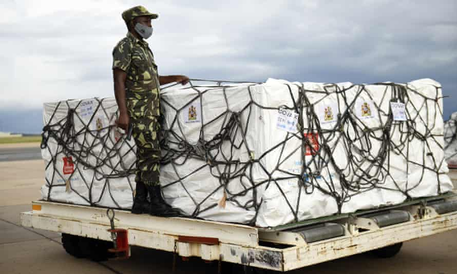 A policeman guards a shipment of Covid vaccines at Kamuzu airport in Lilongwe, Malawi.