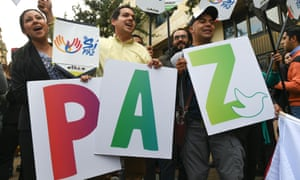 People with placards form the word 'peace' in Bogota, Colombia on 19 July 2016