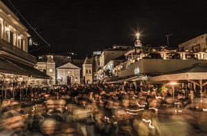 This flurry of motion is a midnight Easter procession in Zakynthos Town, on the Ionian island of Zakynthos. The congregations of the various churches return to their homes carrying candles.