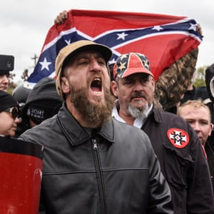 A demonstrator holds up a Confederate flag at a White Lives Matter rally in Shelbyville, Tennessee, on 28 October