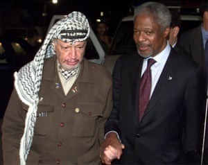The Palestinian president, Yasser Arafat, walks with Annan's after they concluded talks in Gaza in 2000