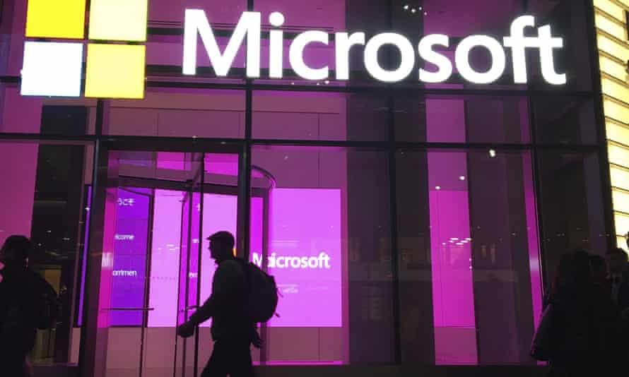 People walk near a Microsoft office in New York