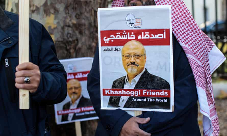 Protesters holding placards demonstrate against the killing of journalist Jamal Khashoggi in London