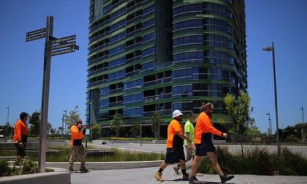 Construction workers are seen in front of Opal Tower