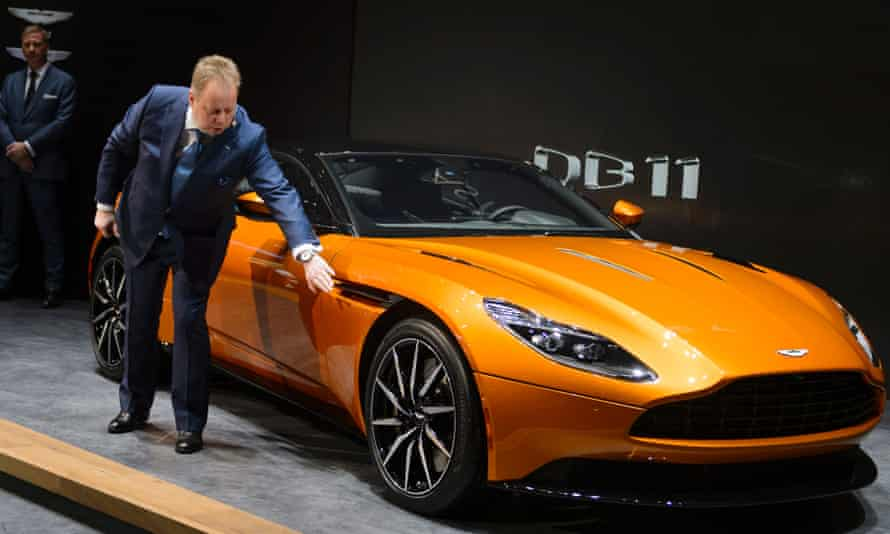 Aston Martin chief executive Andy Palmer with the new DB11 at the Geneva Motor Show in March this year.