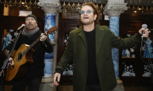 U2's The Edge and Bono take part in the annual Christmas Eve busk on Grafton Street, Dublin.