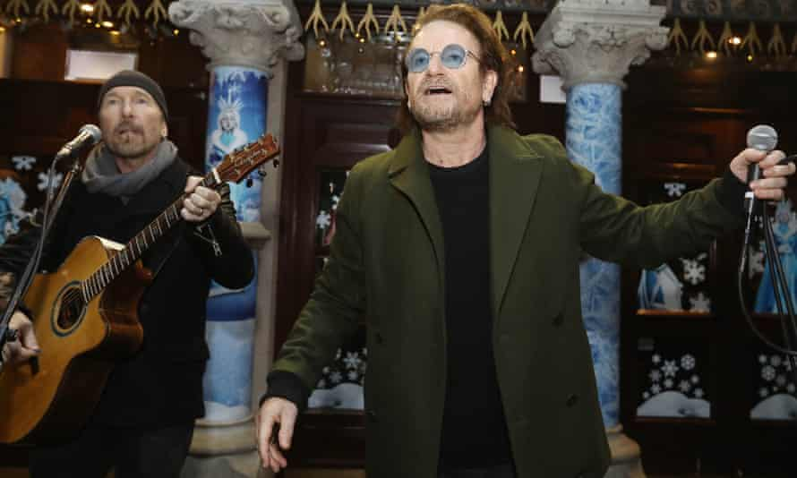The Edge and Bono of U2 take part in the annual Christmas Eve busk in Dublin.