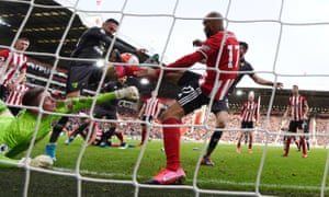 Dean Henderson, left, battles to keep the ball out in Sheffield United's win over Norwich.
