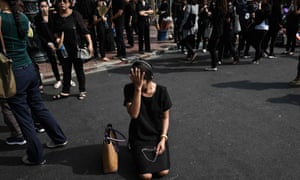 mourners dressed in black in Thailand