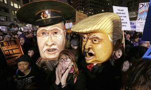 Effigies of Vladimir Putin and Donald Trump at rally in Seattle.