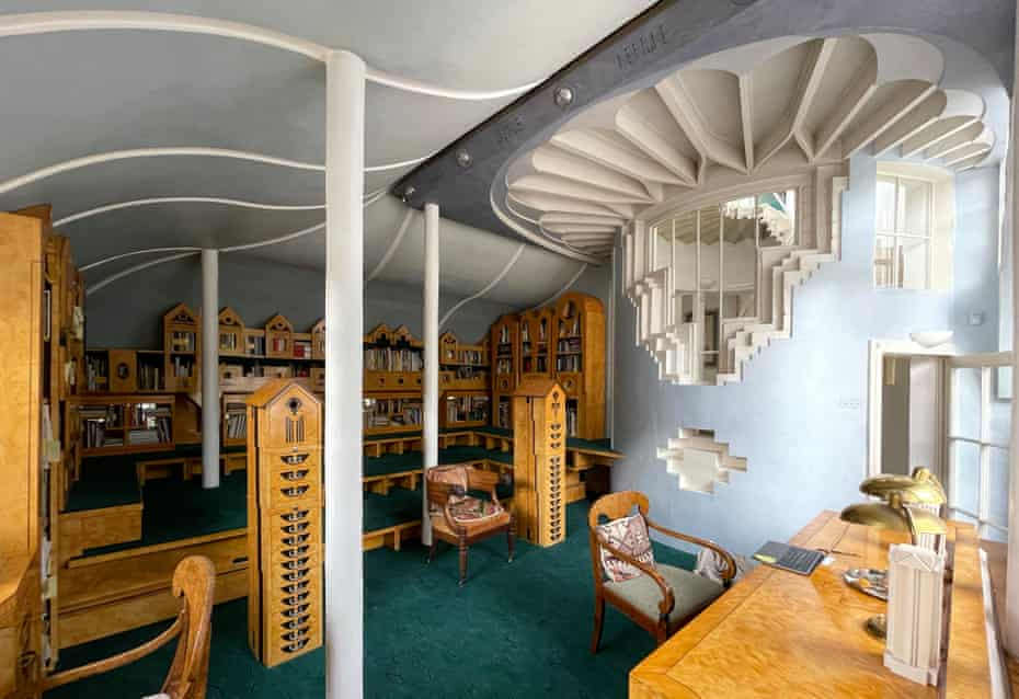 Ultimate fakery … the library is all painted MDF and leads off the Solar Stair to the right.