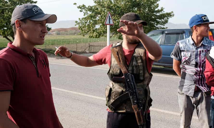 Armed men from the village of Kyzyl-Bel on a road in Kyrgyzstan's south-western Batken region  during the fighting along the Kyrgyz-Tajik disputed border.