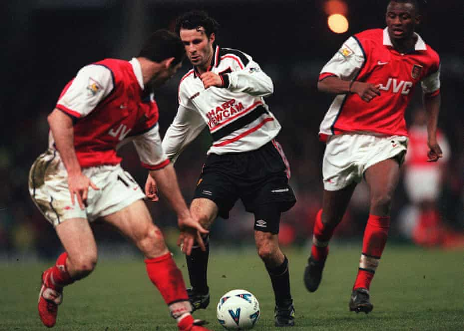 Ryan Giggs takes on the Arsenal defence to score the winner for Manchester United.