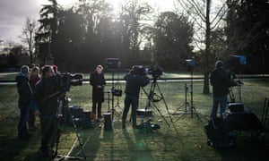 Members of the media preparing to broadcast from within the Sandringham estate in King's Lynn.