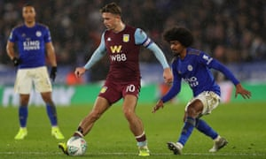 Jack Grealish holds off Leicester's Hamza Choudhury during Aston Villa's Carabao Cup semi-final, first leg at the King Power Stadium.