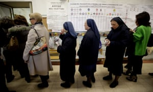 People lining up to vote at a polling station in Rome.