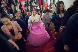 Delegates arrive inside the Great Hall