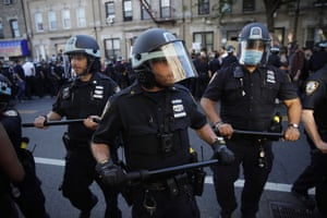 New York City Police officers and protesters clash during a demonstration in Brooklyn on 30 May.
