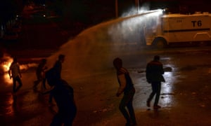 Turkish riot police use water cannon during clashes with Kurdish protesters in the south-eastern city of Diyarbakir on 1 November.