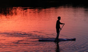 Stand-up paddleboarding is popular with the family