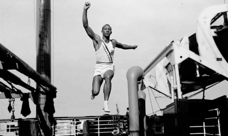 Jesse Owens takes a practice jump aboard the S.S. Manhattan, en route to Berlin in 1936.