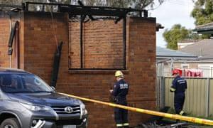 Police outside burned home in Singleton