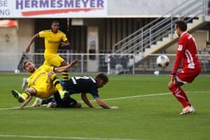Marcel Schmelzer (L) of Borussia Dortmund scores his team's fifth goal.