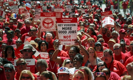 Verizon workers take part in a rally in New York as they negotiate a union contract.