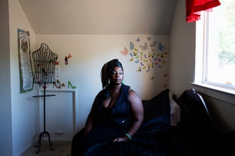 Willia, 37, sits on a bed at a Sex Workers Outreach Project house in Sacramento, California, in September.