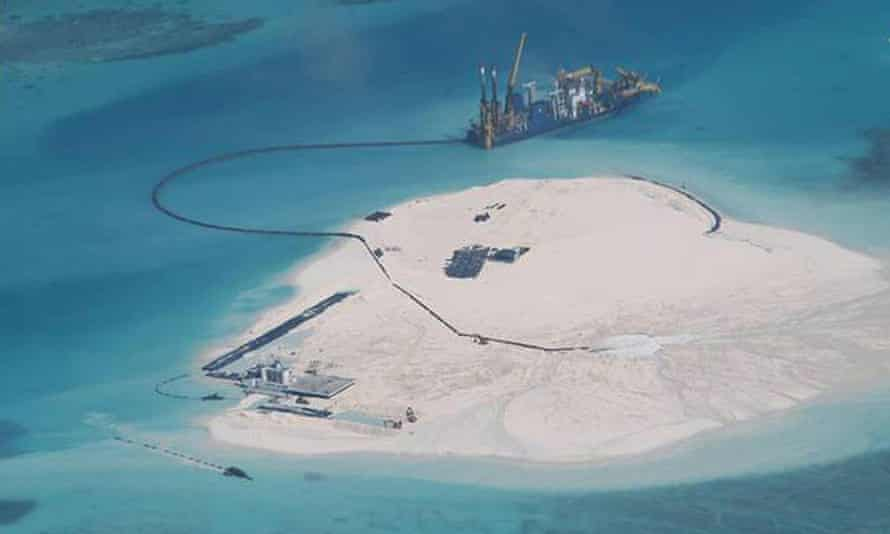 A photo taken by surveillance planes of the Philippine Department of Foreign Affairs shows a Chinese vessel expanding structures and land on the Johnson Reef, called Mabini by the Philippines and Chigua by China, at the Spratly Islands in the South China Sea, Philippines.