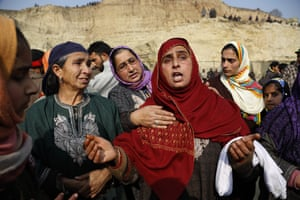 <strong>Pulwama, Kashmiri</strong><br>Relatives of Manzoor Ahmad cry during his funeral. Two suspected insurgents of the Lashkar-e-Taiba group were killed in a gunfight with security forces