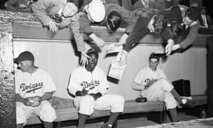 Jackie Robinson is the centre of attention for young Brooklyn Dodgers fans at Ebbets Field in 1947 after becoming the first black player to reach the Major League.