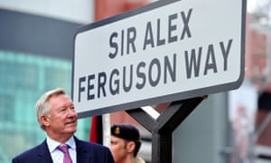 Sir Alex Ferguson, pictured in 2013, unveils a sign after a road near to Old Trafford was renamed in his honour in Manchester.